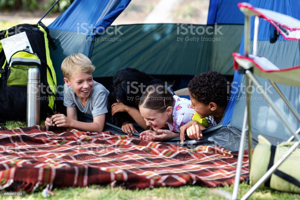 Family having fun in the tent stock photo
