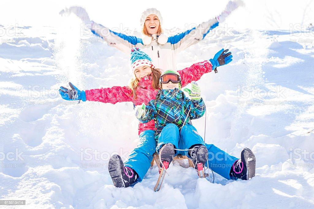 Family having fun in winter stock photo