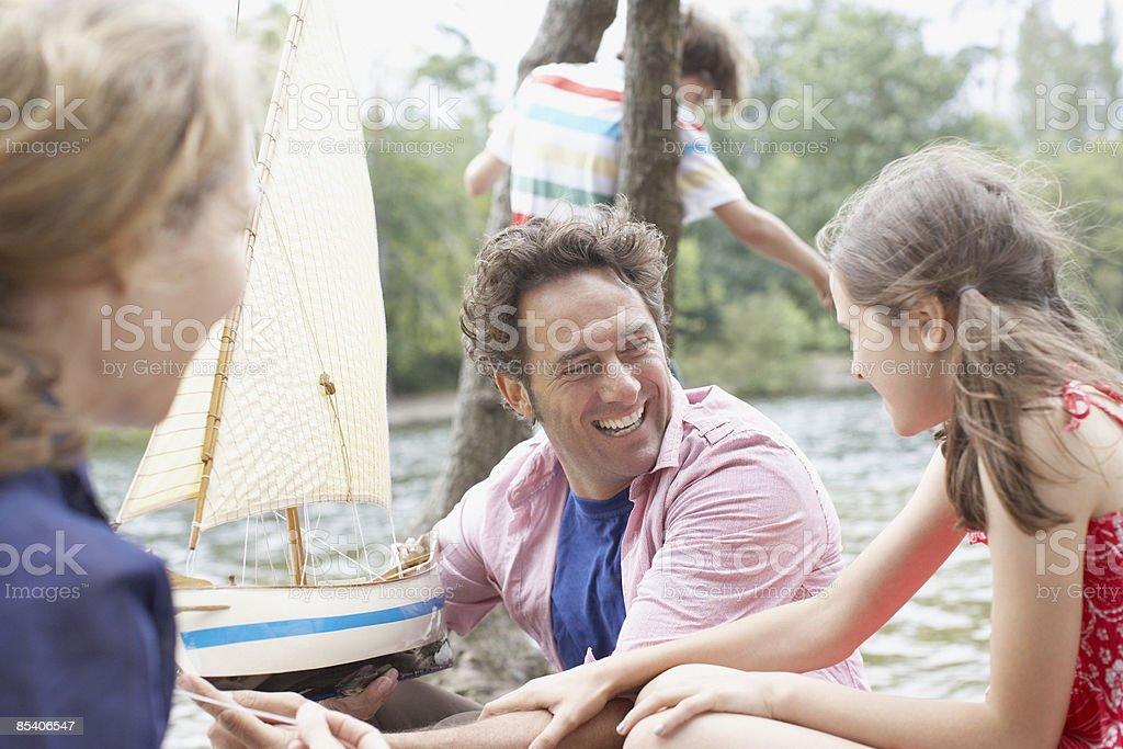 Family having fun near lake royalty-free stock photo
