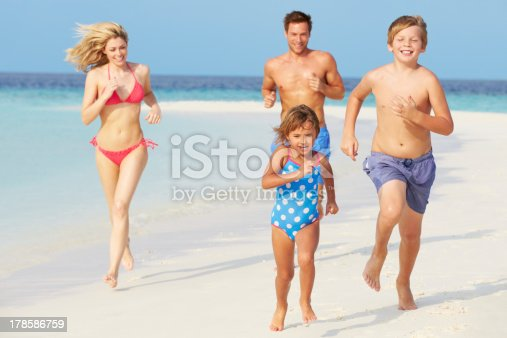 istock Family Having Fun On Beach Holiday 178586759