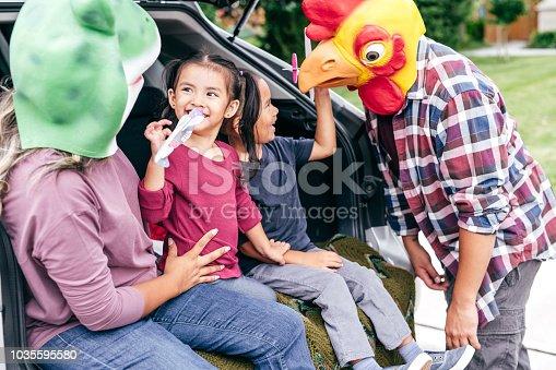 528474010istockphoto Family having fun on Halloween's Eve 1035595580