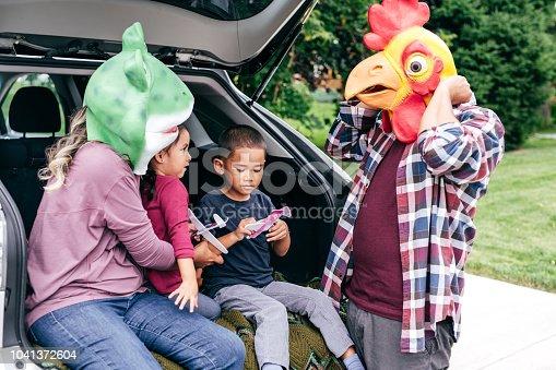 528474010istockphoto Family having fun on Halloween's Eve 1041372604