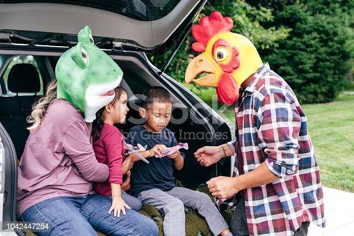 528474010istockphoto Family having fun on Halloween's Eve 1042447254