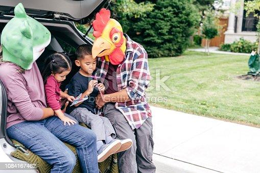 528474010istockphoto Family having fun on Halloween's Eve 1084167462