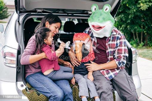 528474010istockphoto Family having fun on Halloween's Eve 1158915321