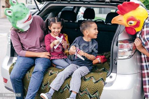 528474010istockphoto Family having fun on Halloween's Eve 1158915323