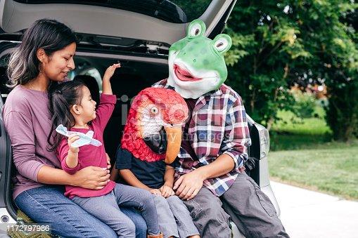 528474010istockphoto Family having fun on Halloween's Eve 1172797986