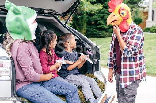528474010istockphoto Family having fun on Halloween's Eve 1172836113