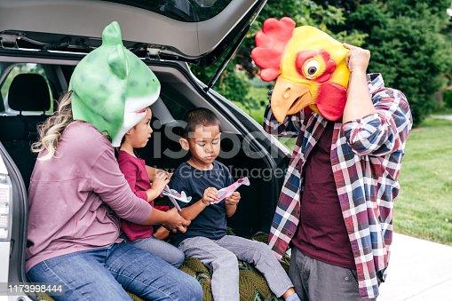 528474010istockphoto Family having fun on Halloween's Eve 1173998444