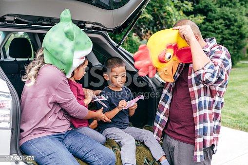 528474010istockphoto Family having fun on Halloween's Eve 1174901478