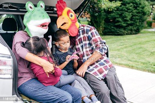 528474010istockphoto Family having fun on Halloween's Eve 1181098797