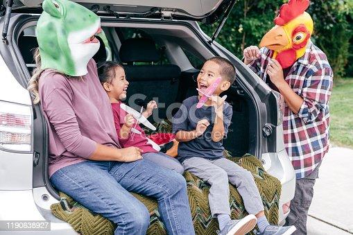528474010istockphoto Family having fun on Halloween's Eve 1190638927