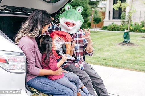 528474010istockphoto Family having fun on Halloween's Eve 1191524957