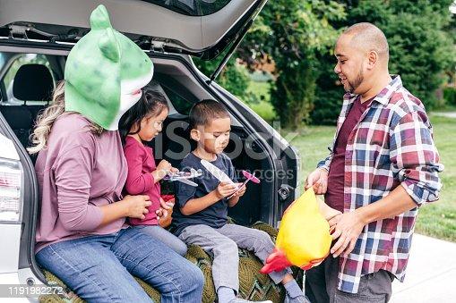 528474010istockphoto Family having fun on Halloween's Eve 1191982272