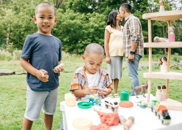 family having fun outdoor - happy mom packing some toys stock photos and pictures