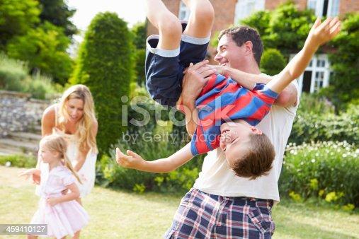 istock Family Having Fun Playing In Garden 459410127
