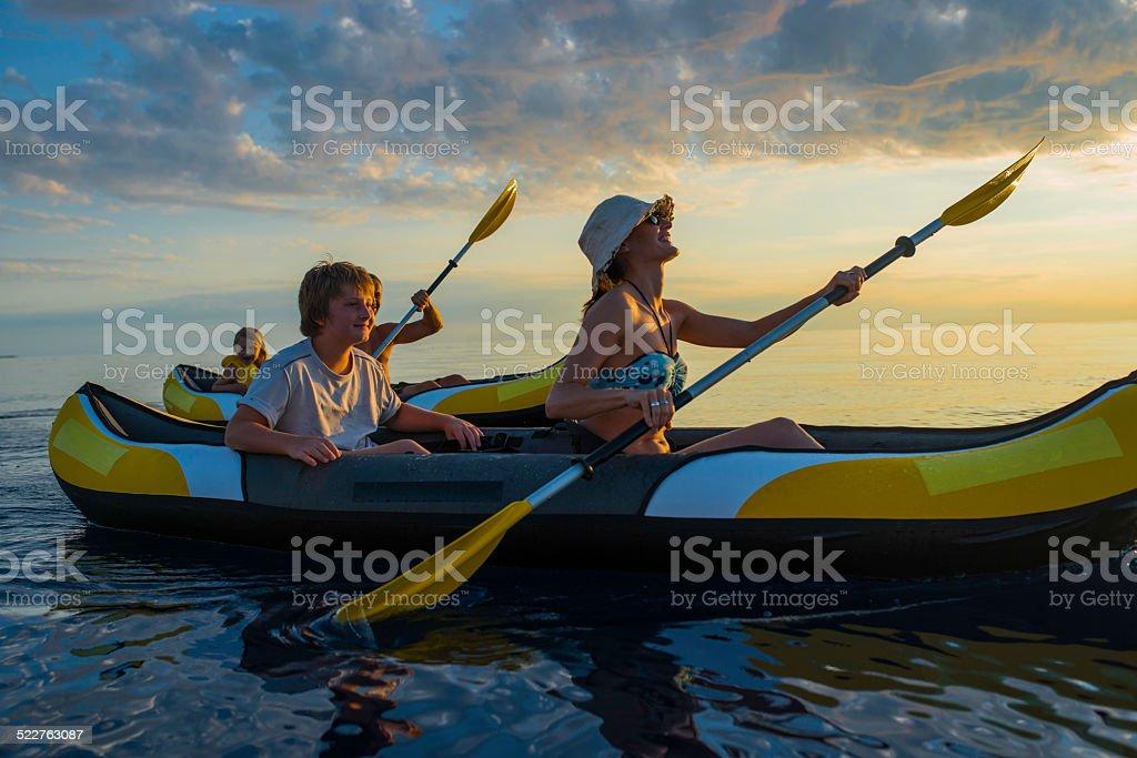 Family Having Fun Sea Kayaking stock photo