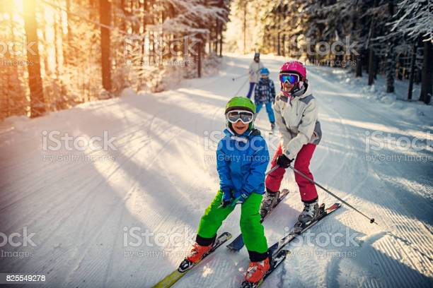 Family having fun skiing together on winter day picture id825549278?b=1&k=6&m=825549278&s=612x612&h=a8ph3ujbjut8ytvp7qerm fuan46qpnsjtz9y6bqhgk=