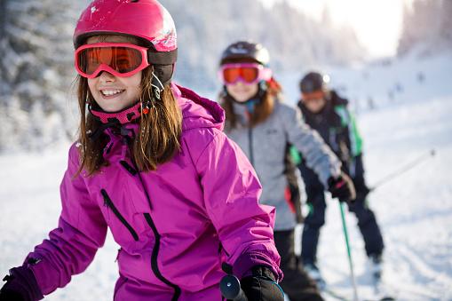 Family having fun skiing together
