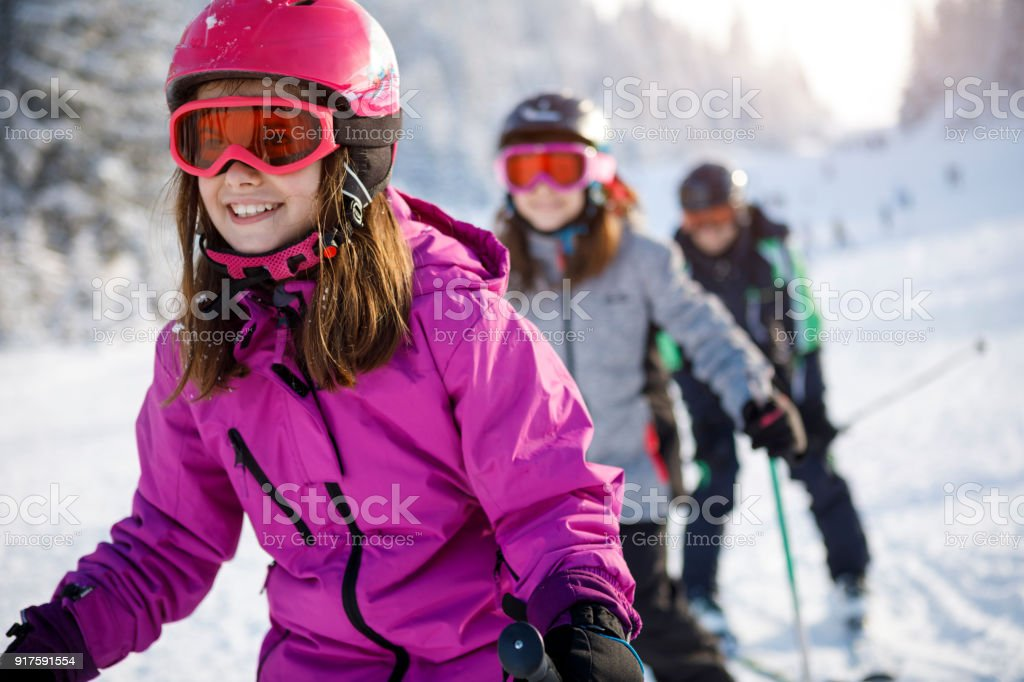 Family having fun skiing together stock photo