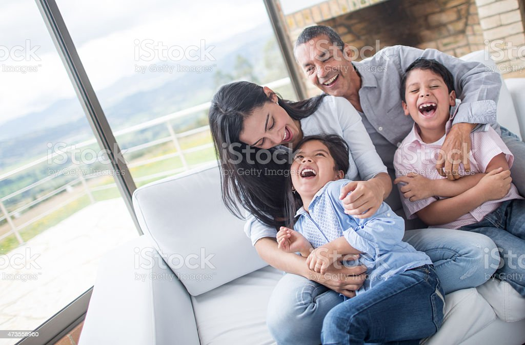 Family having fun tickling each other stock photo