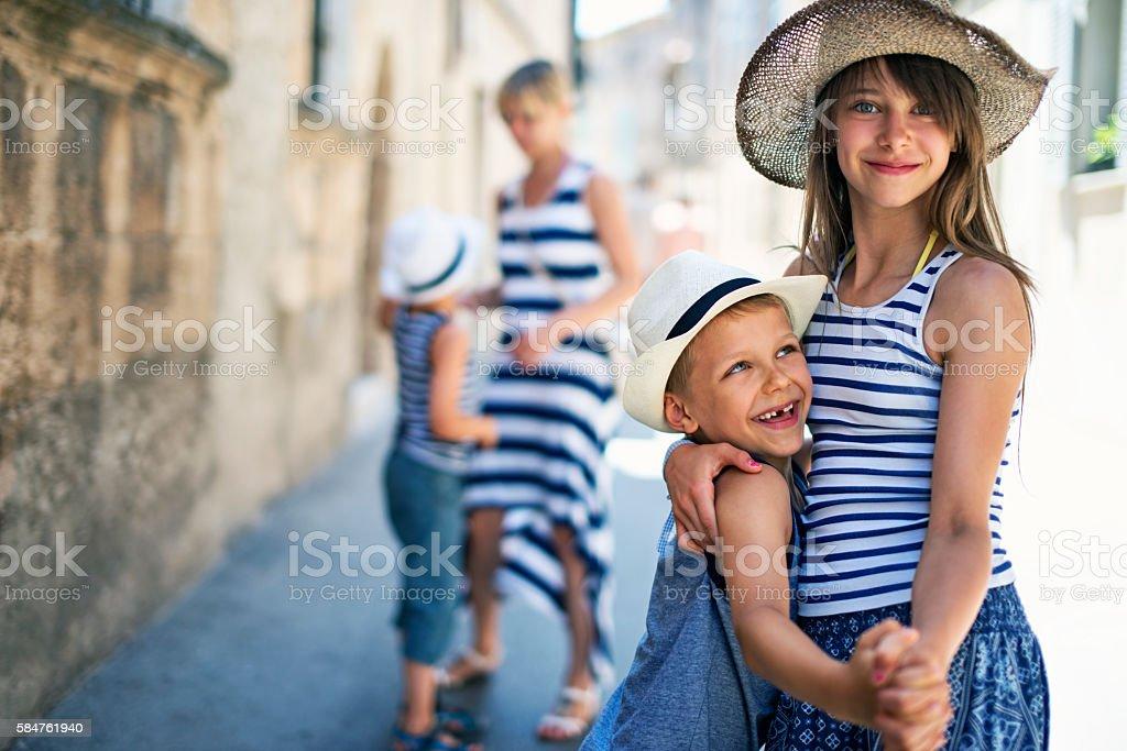 Family having fun visiting the beautiful Majorcan town of Pollenca stock photo