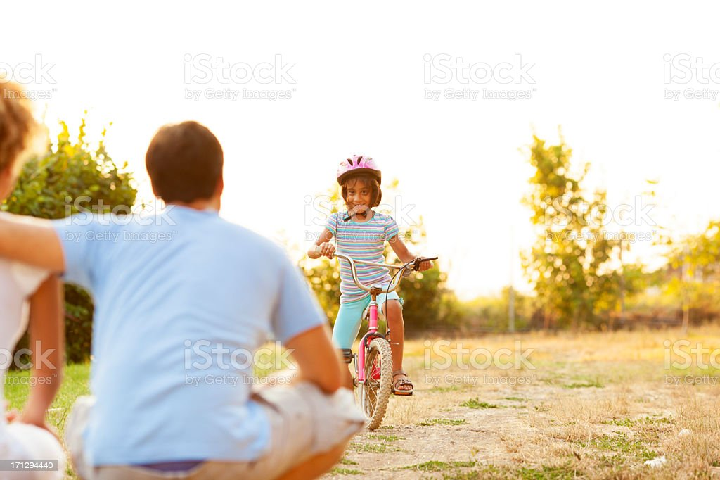 Family Having Fun With Bicycle Outdoors. royalty-free stock photo