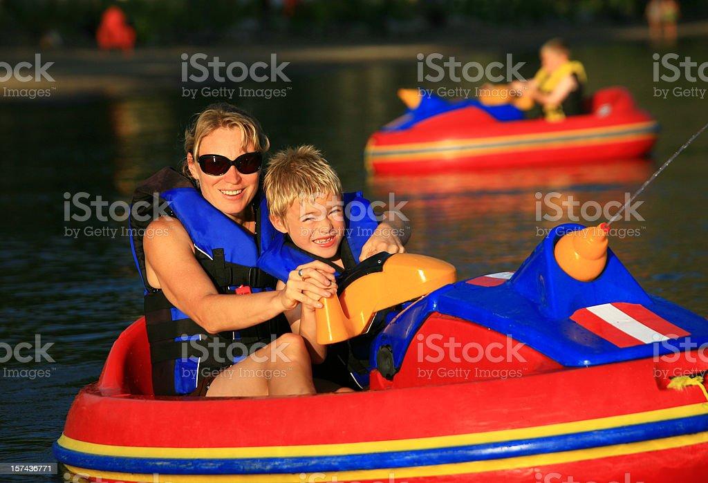 Family Having Fun with Bumper Boats stock photo