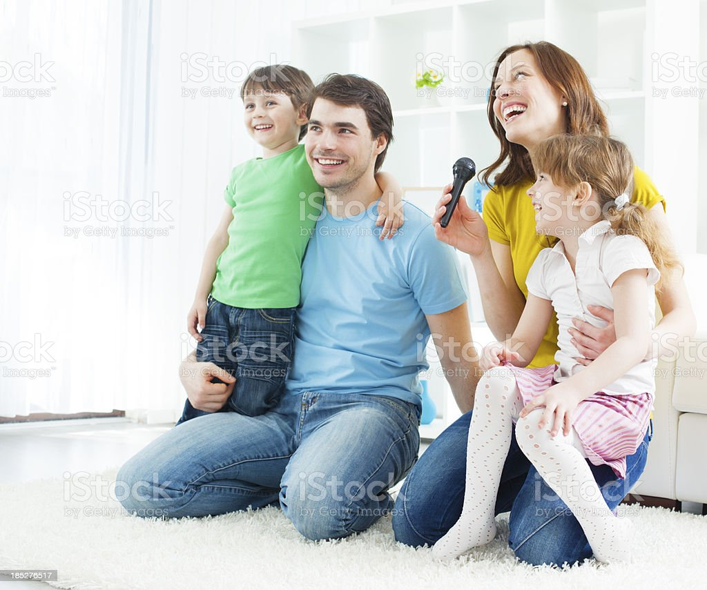Family Having fun with karaoke stock photo