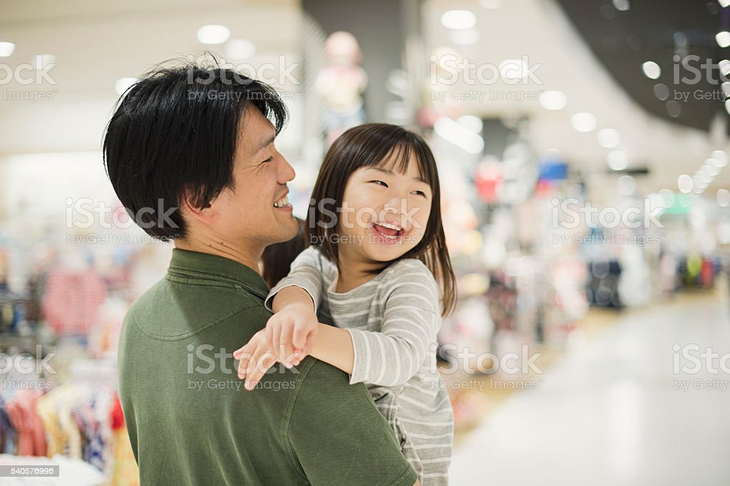 Family having good time in the supermarket. stock photo