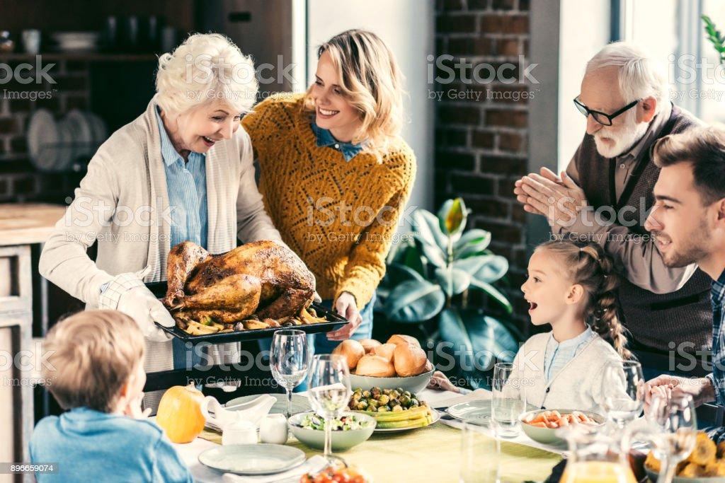 family having holiday dinner stock photo