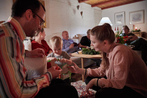 Family having hygghe Christmas evening stock photo