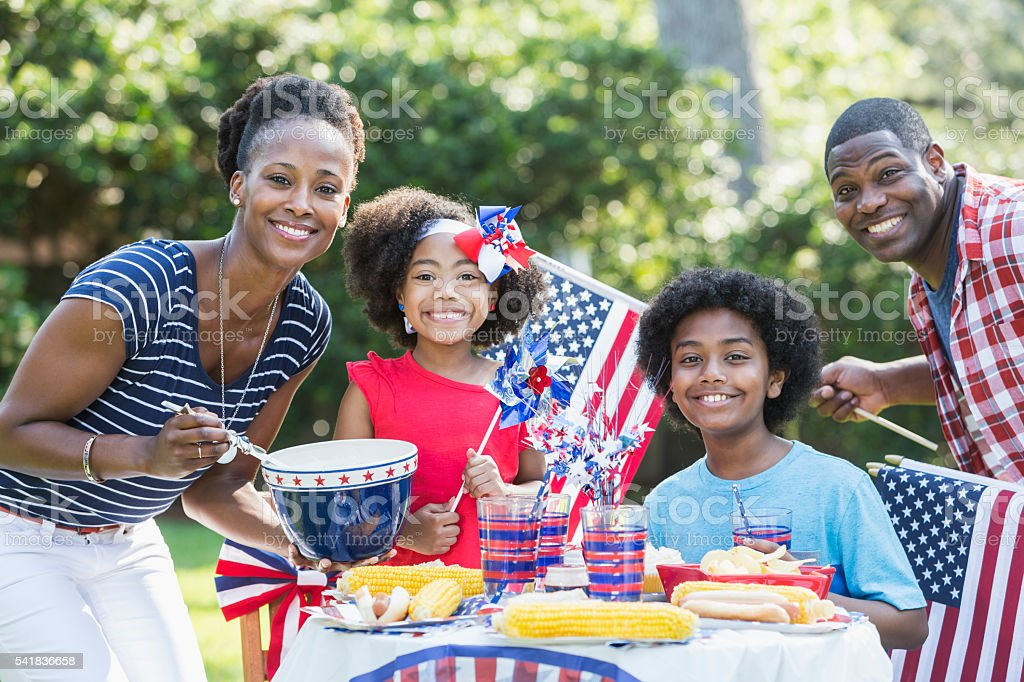 Family having July 4th or Memorial Day picnic stock photo