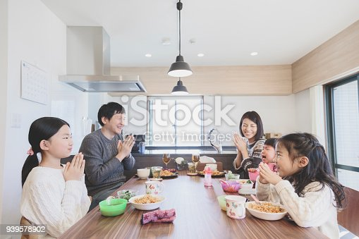1152545468 istock photo Family having lunch at home 939578902