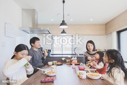 1152545468 istock photo Family having lunch at home 939578904
