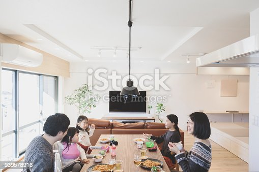 1152545468 istock photo Family having lunch at home 939578916