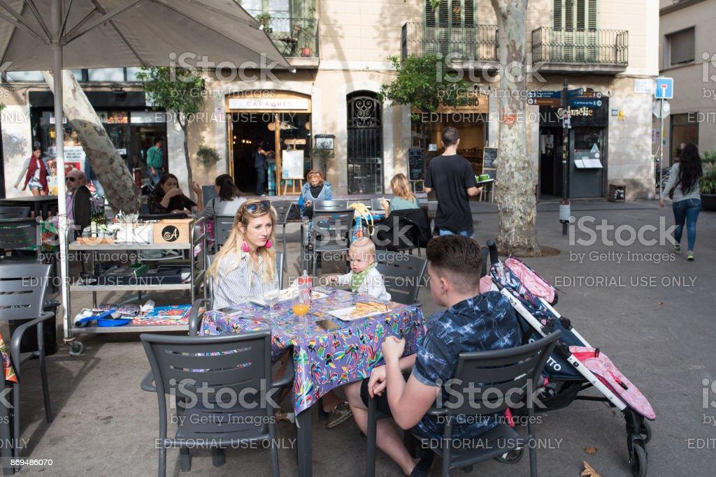 Family having lunch in Gracia, Barcelona stock photo
