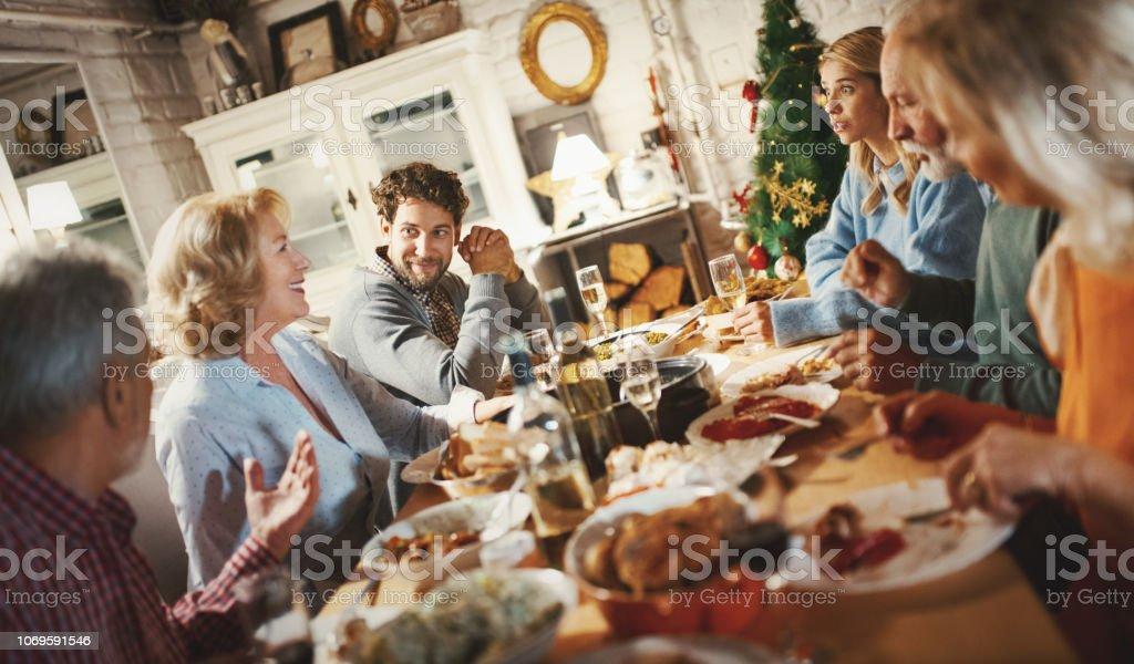 Family having Thanksgiving dinner. - Foto stock royalty-free di 60-69 anni