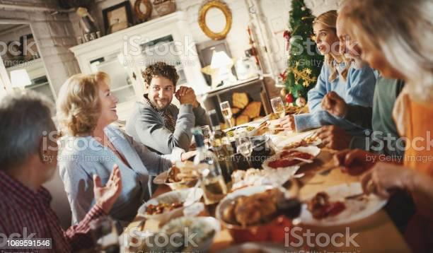 Family Having Thanksgiving Dinner - Fotografie stock e altre immagini di 60-69 anni