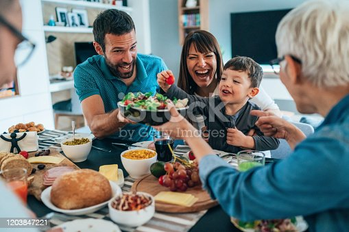 Big happy family have fun and having healthy meal together on the table