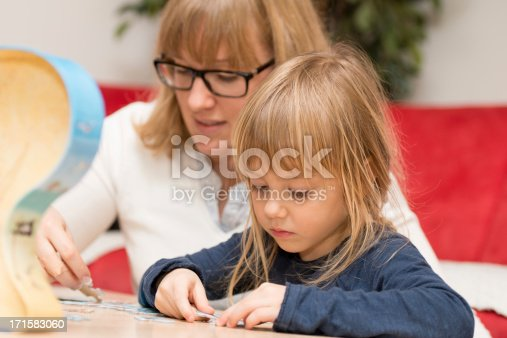 istock family helps gain knowledge for children 171583060