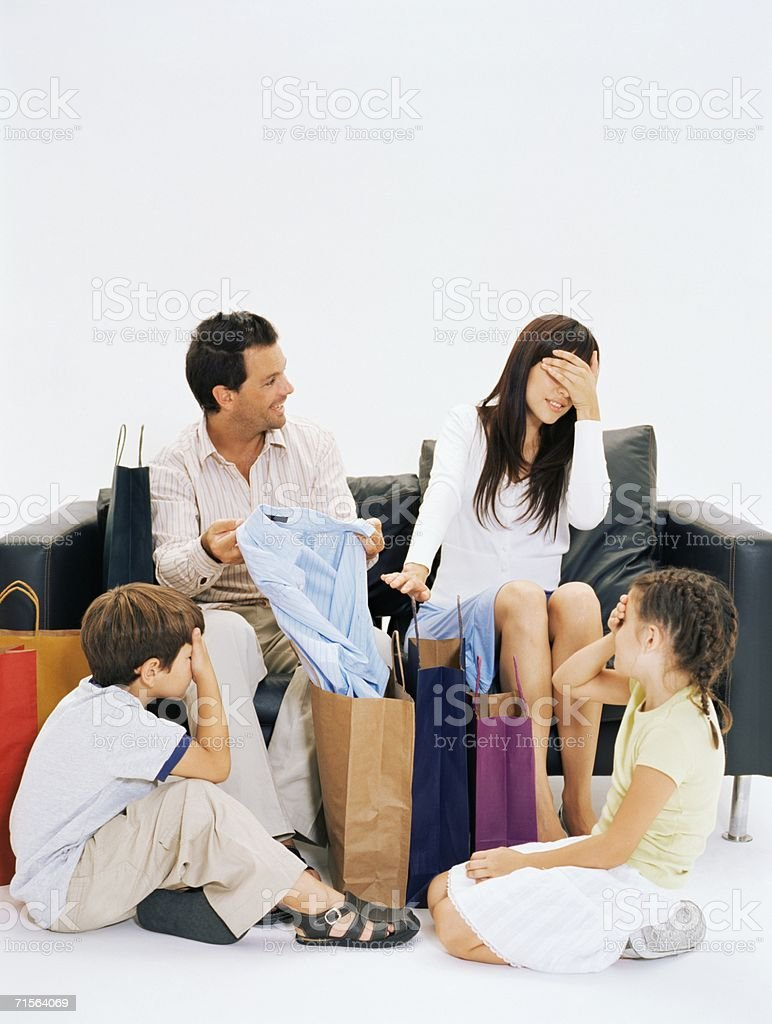 Family hiding eyes from father's shirt royalty-free stock photo