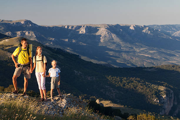 Family hiking at the mountains stock photo