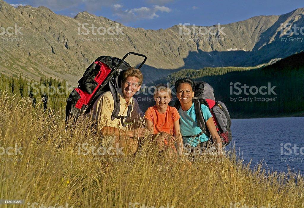 Family Hiking beside Mountain Lake royalty-free stock photo