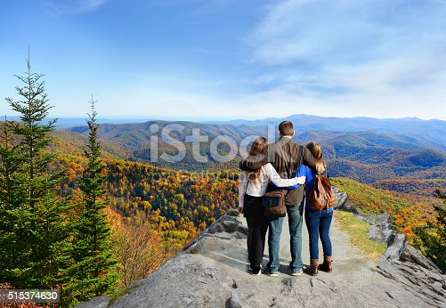 istock Family hiking in autumn mountains. 515374630