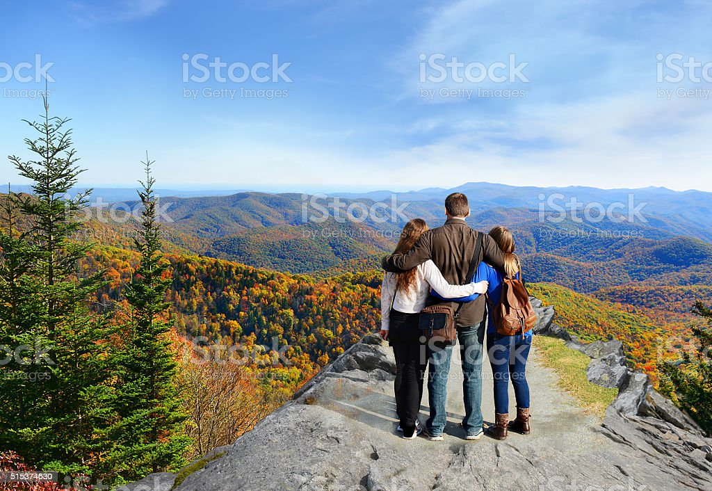 Family hiking in autumn mountains. stock photo
