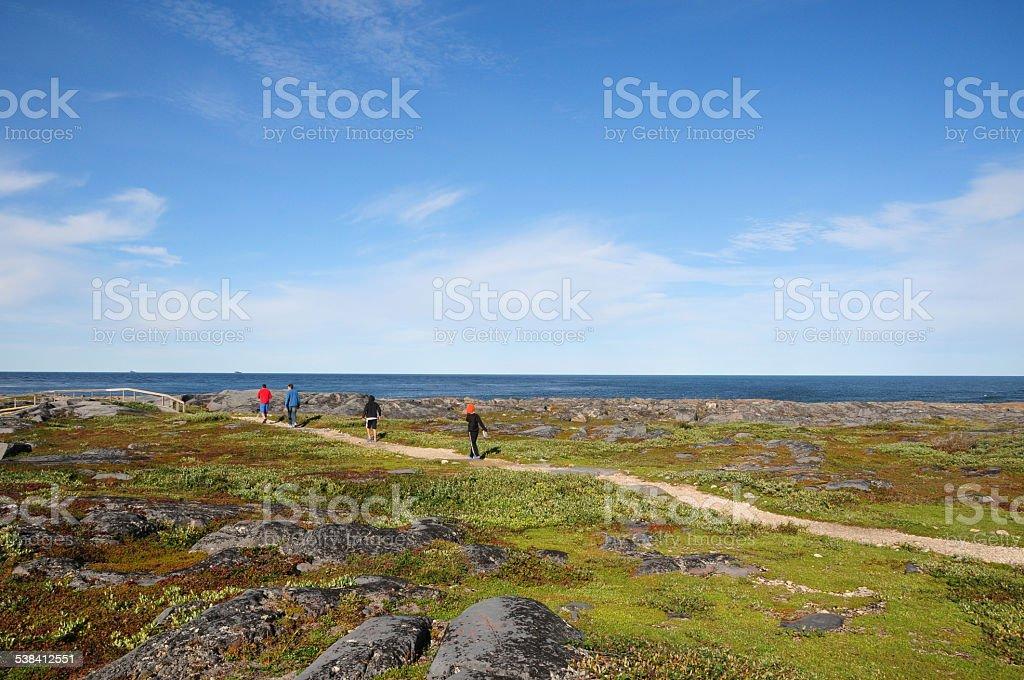 Family hiking in Cape Mary, Churchill, Manitoba, Canada stock photo