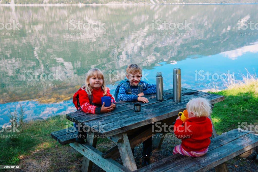 family hiking. kids having picnic in scenic nature royalty-free stock photo