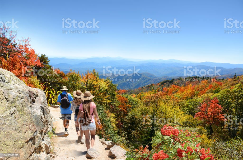 Family hiking on vacation in autumn mountains. stock photo
