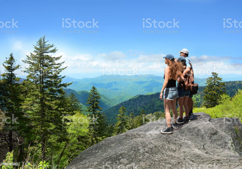 Family hiking on vacation in summer mountains. royalty-free stock photo